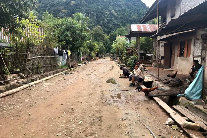 Water bottle people Muang Ngoy